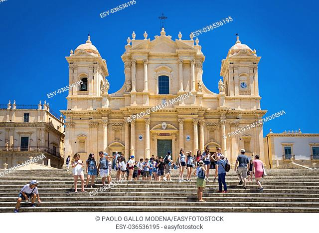 Turists in front of the most important baroque cathedral of Sicily, San Nicolò, Unesco Heritage site, sunny day