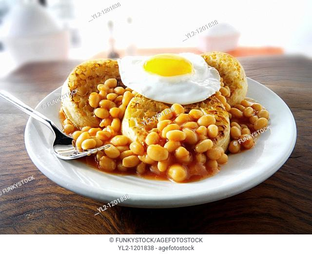 Baked beans on crumpets with fried egg on top