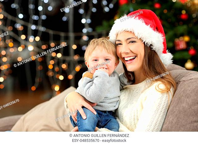 Mother and son looking at you posing in christmas