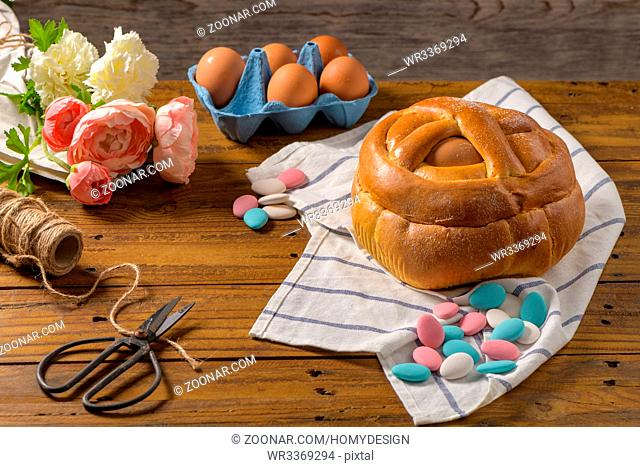 Easter folar with egg on wooden table top