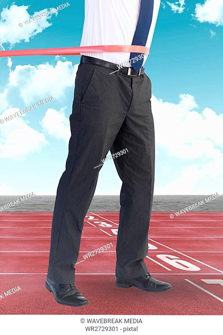 Digital composite image of businessman winning the race