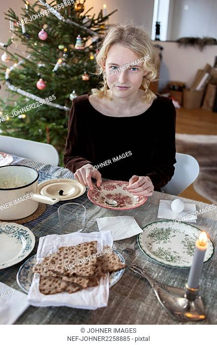 Portrait of teenage girl during Christmas meal