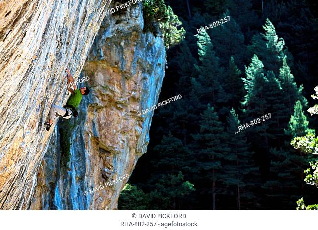 A climber scales cliffs at Bielsa, Spanish Pyrenees, Spain, Europe