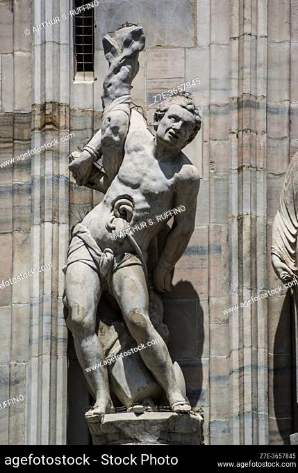 Sculpture of St. Elmo (Erasmus). Telephoto of sculpture on exterior of Milan Cathedral (Duomo di Milano). Piazza del Duomo, Milan, Lombardy, Italy, Europe