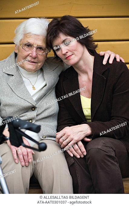 Older woman consoling her adult daughter
