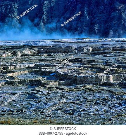 Steam emerging from a hot spring, Mount Everts, Mammoth Hot Springs, Yellowstone National Park, Wyoming, USA