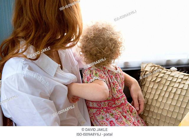 Mother & child looking out window