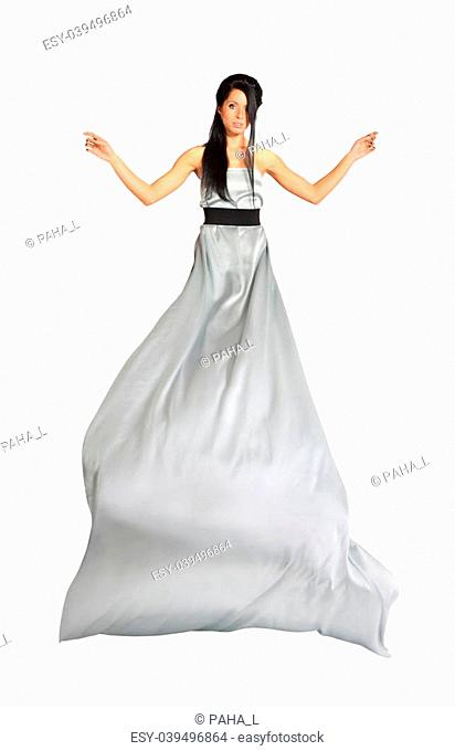 beautiful girl wearing long silver dress isolated on white background; skirt flutters; full body