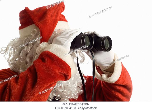 Father Christmas looking at the future business strategy with binoculars to the right