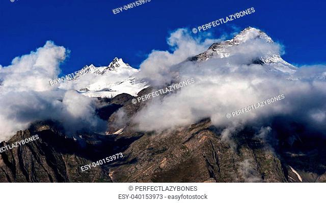 Himalaya high mountain landscape panorama with snow cup at dawn. India, Himachal Pradesh, Keylong village