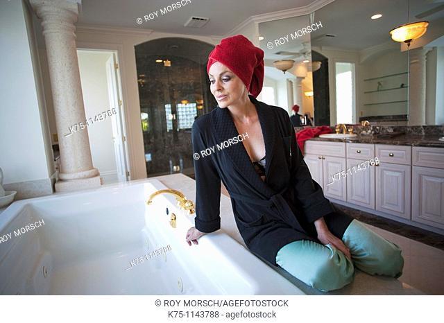 Woman getting her bath ready