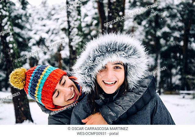 Portrait of happy young couple in winter forest