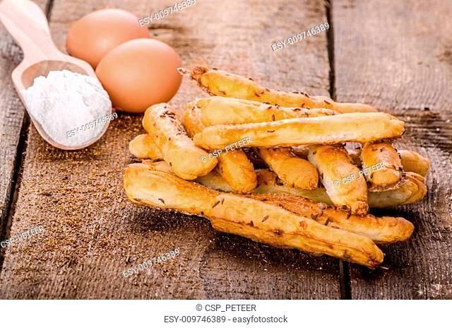 Home baked sticks with cumin and salt
