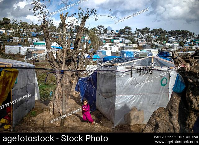 27 February 2020, Greece, Lesbos: A child plays in a temporary tent camp near the camp for migrants in Moria. Following serious clashes between police and angry...