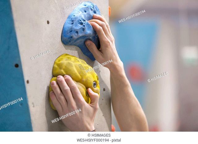 Germany, Bavaria, Munich, Young man bouldering