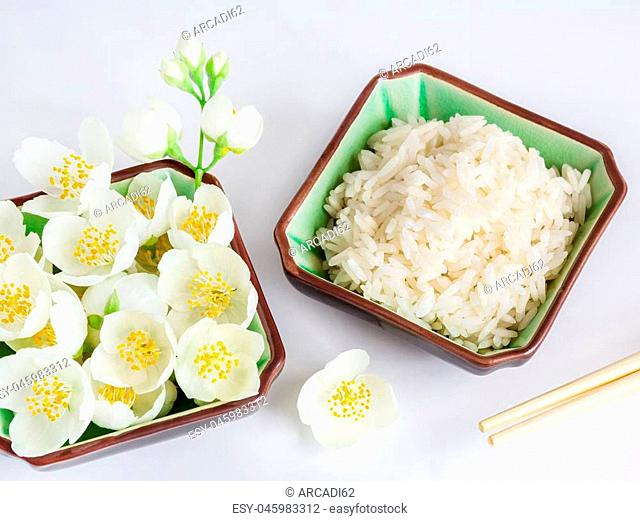 healthy power concept, Eco, a dish with jasmine rice and jasmine flowers on a wooden background