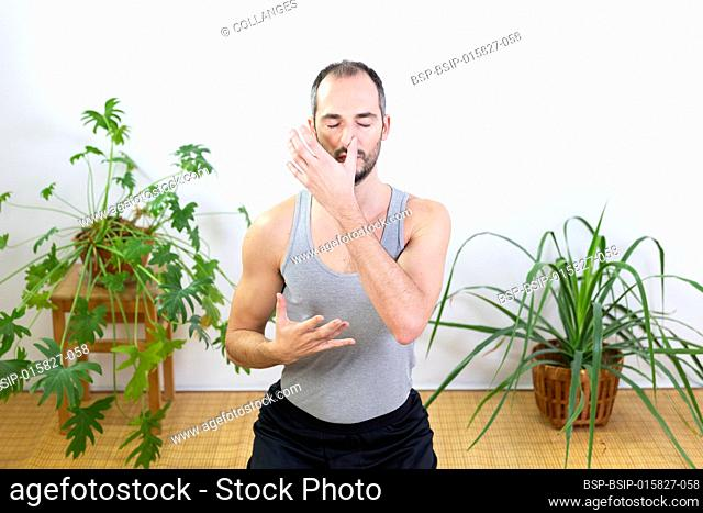 A man doing breathing exercises