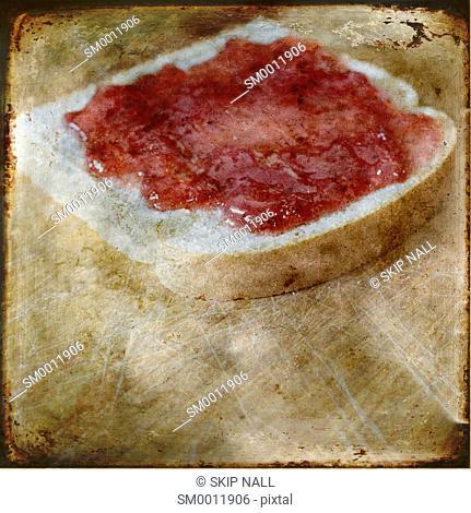 Fresh beard with strawberry jelly sitting on a cutting board