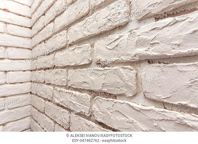 Designer hand-made imitation brickwork on the wall of the apartment