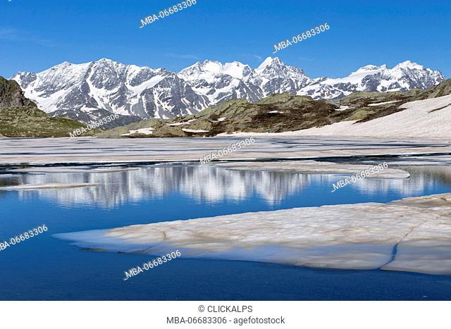 The ice is melting as summer approaches on this lake in Piz Lunghin, Switzerland