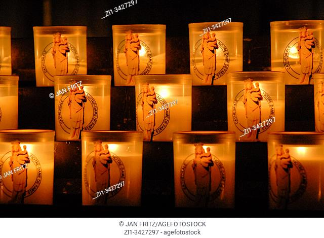 lit candles in Notre Dame in Paris, France