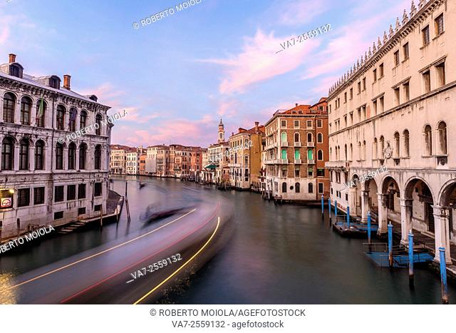 Winter sunset and gondolas along the Grand Canal in Venice, Veneto Italy Europe