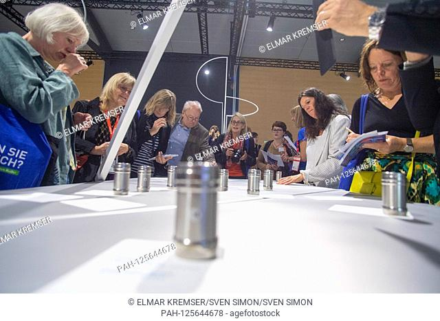Fair visitors try samples, INVISIBLE SILENCE is a collaboration between Sissel Tolaas (not pictured) and Erling Kagge (not pictured) for Norway's Guest of Honor...
