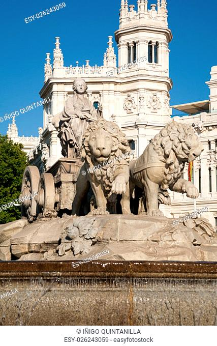landmark of famous neoclassical sculpture monument fountain of greek goddess Cibeles in Madrid city Spain Europe, facade of public town hall building
