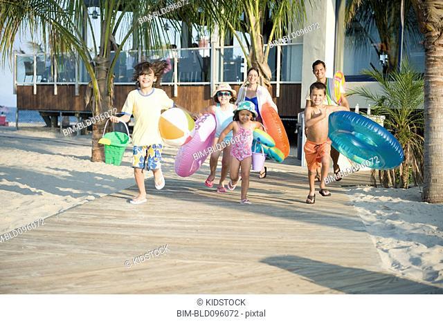 Hispanic family rushing to beach