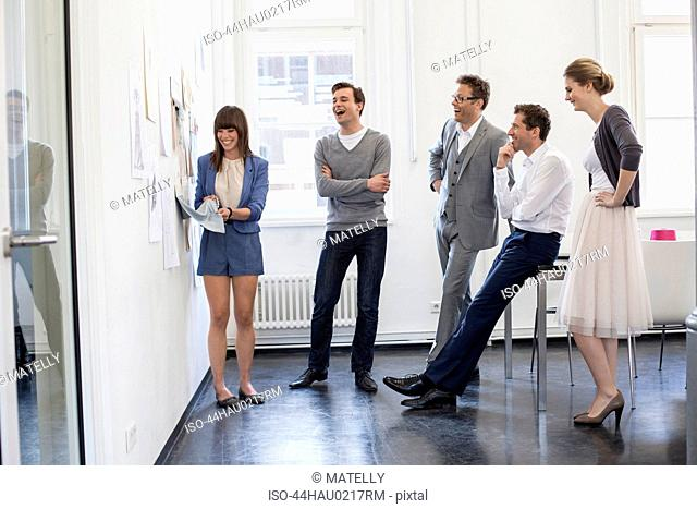 Business people examining fabric swatch