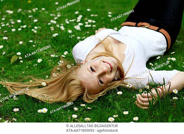 Young girl lying in a meadow