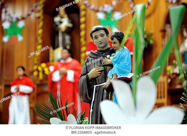 Statue of a saint, St. Anthony, Whitsun mass, Dios Con Nosotros church parish, El Mesquital, Guatemala City, Guatemala, Central America