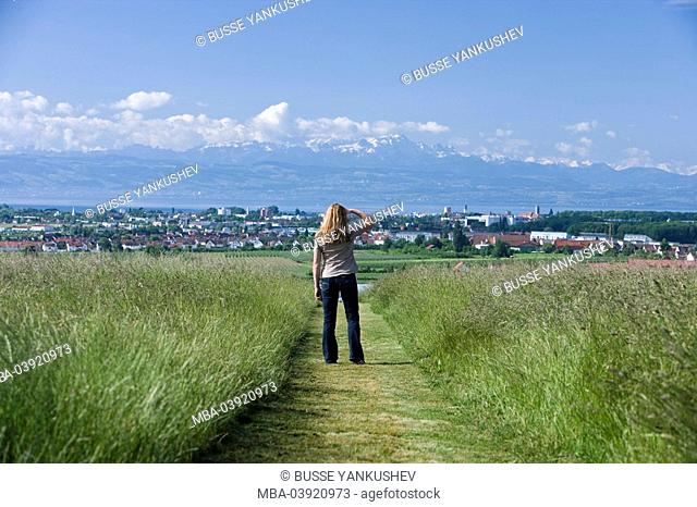 Germany, Baden-Württemberg, Lake Constance-district, Friedrichshafen, railway line, woman, back view