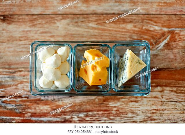 different kinds of cheese in glass cups