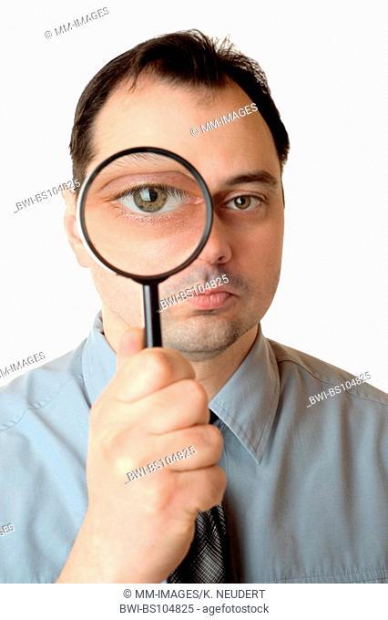 man watching through lens