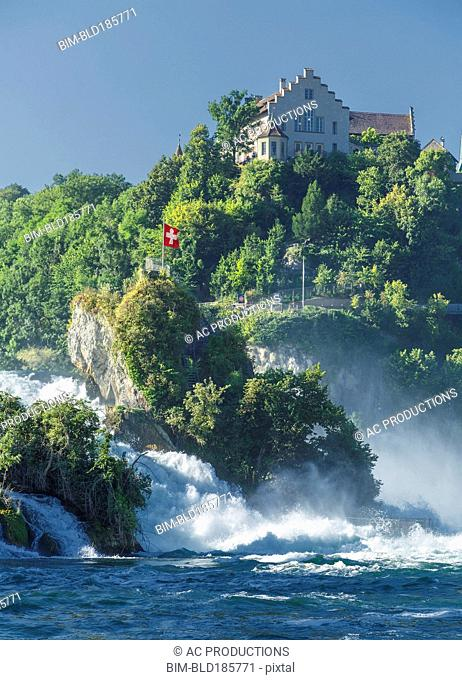 House on cliff overlooking river