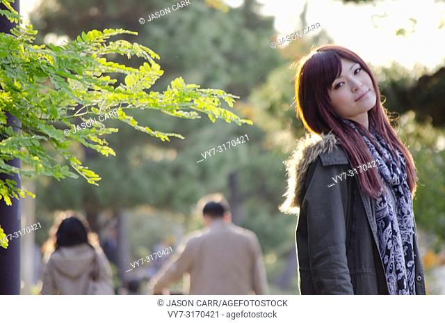 Japanese Girl poses on the street in Odaiba, Japan. Odaiba is a area by the sea in Tokyo
