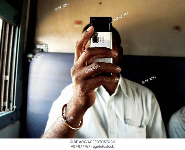 Man in train, Hampi, Karnataka, India