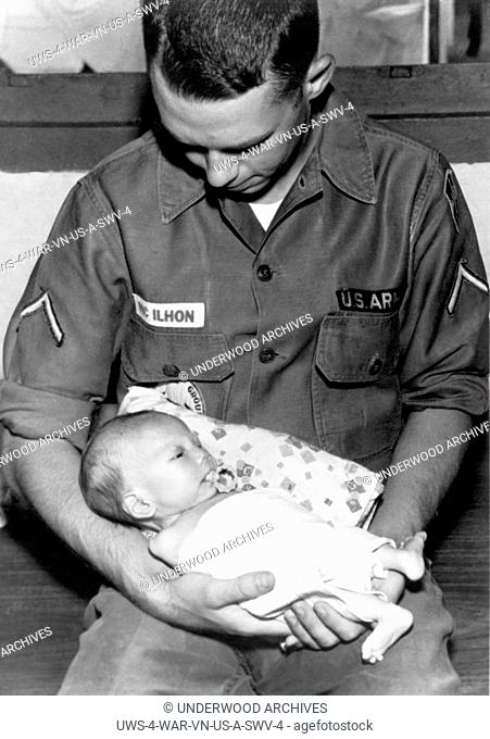 Saigon, Vietnam: August 8, 1966 A private from the 120th Aviation Company spends his off hours with the 800 children at the Go Vap Orphanage outside of Saigon