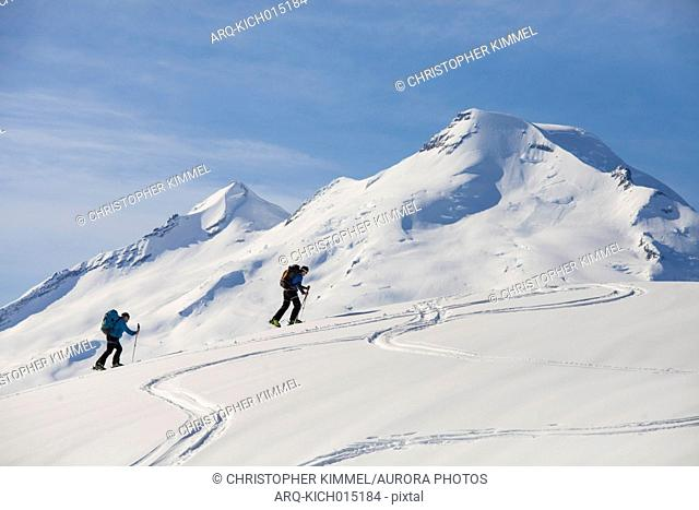 Side view of two men cross-country skiing in North Cascades National Park, Washington State, USA
