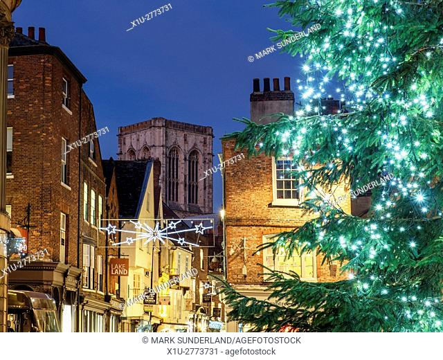 Christmas Tree in St Helens Square with Stonegate and the Minster Beyond York Yorkshire England
