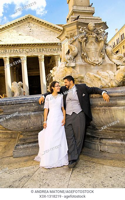 Bride and groom at Pantheon fountain in Rome, Italy