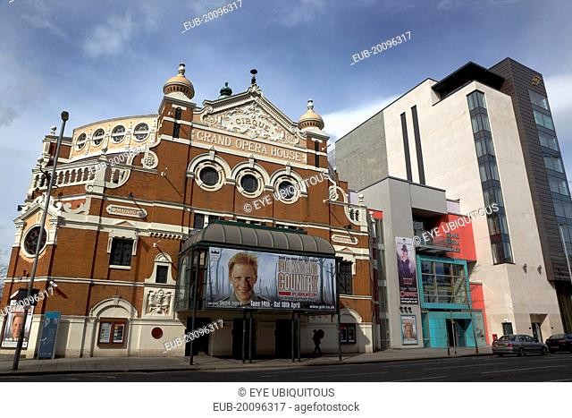 Great Victoria Street, Exterior of the Grand Opera House with its modern new Extension next to the new Fitzwilliam 5 star hotel