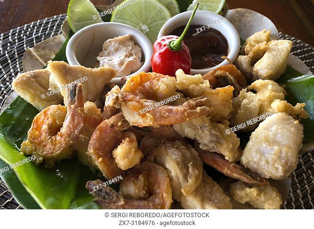 Typical fish food in The Turtle Inn Francis Ford Cappola s beach front hotel Placencia Belize Central America
