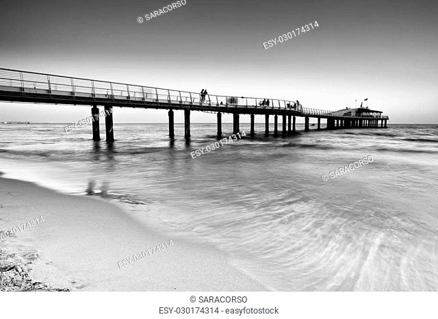 The jetty of Lido di Camaiore in the evening, Tuscany, Italy