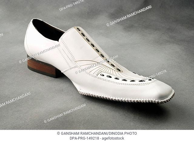 White leather shoe on gray background MR