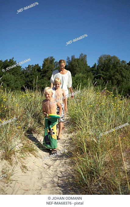 A family walking to the beach Gotland Sweden