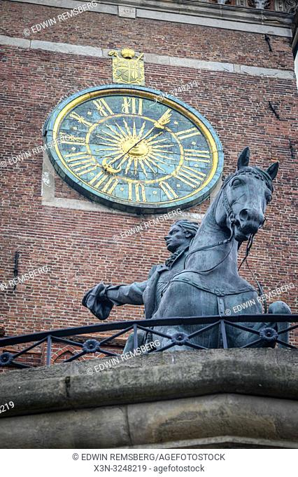 Low angle view of Tadeusz KoŠ›ciuszko Monument with clock face depicting a moon and sun behind it at Wawel Royal Castle, Kraków, Lesser Poland Voivodeship
