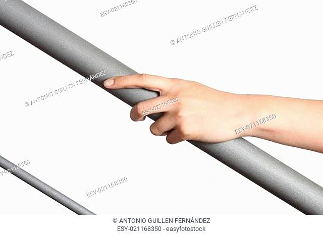 Woman hand resting on a railing