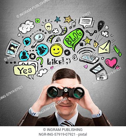 Online life concept. Business man looking through binoculars. Bright sketches overhead